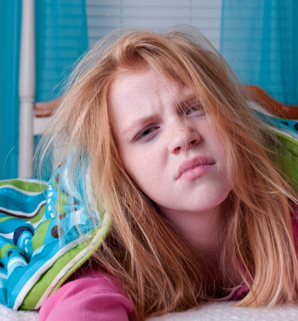 Girl not wanting to wake up for back to school.