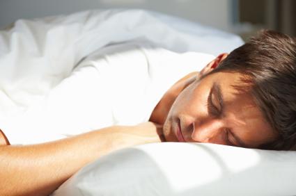 Young Man Sleeping, using a sleep log