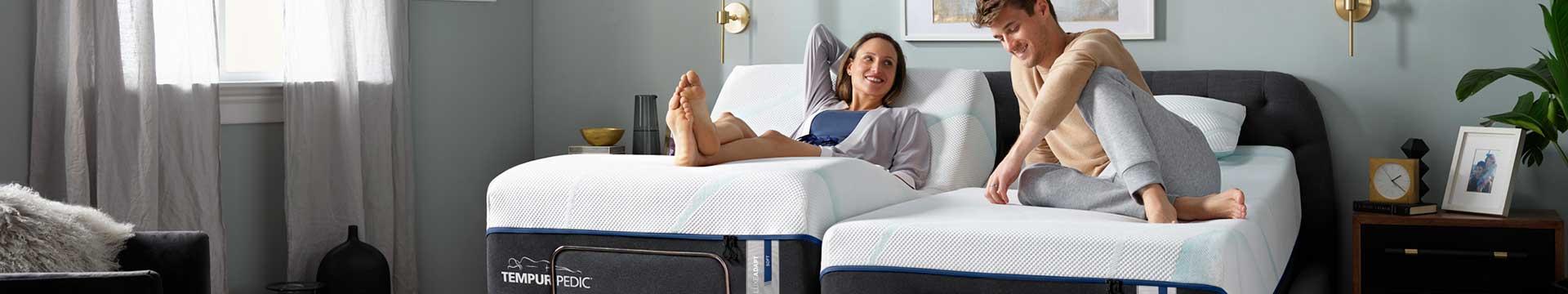 Man and women on a king mattress dual adjustable Tempur-Pedic