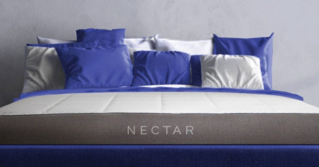 Nectar mattress with blue and white pillows