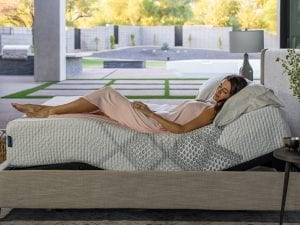 King Koil Lily SmartLife Medium mattress with a women laying on it