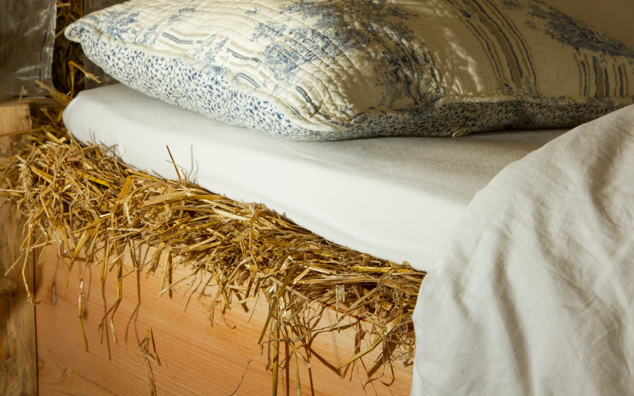 Bed on top of a haystack
