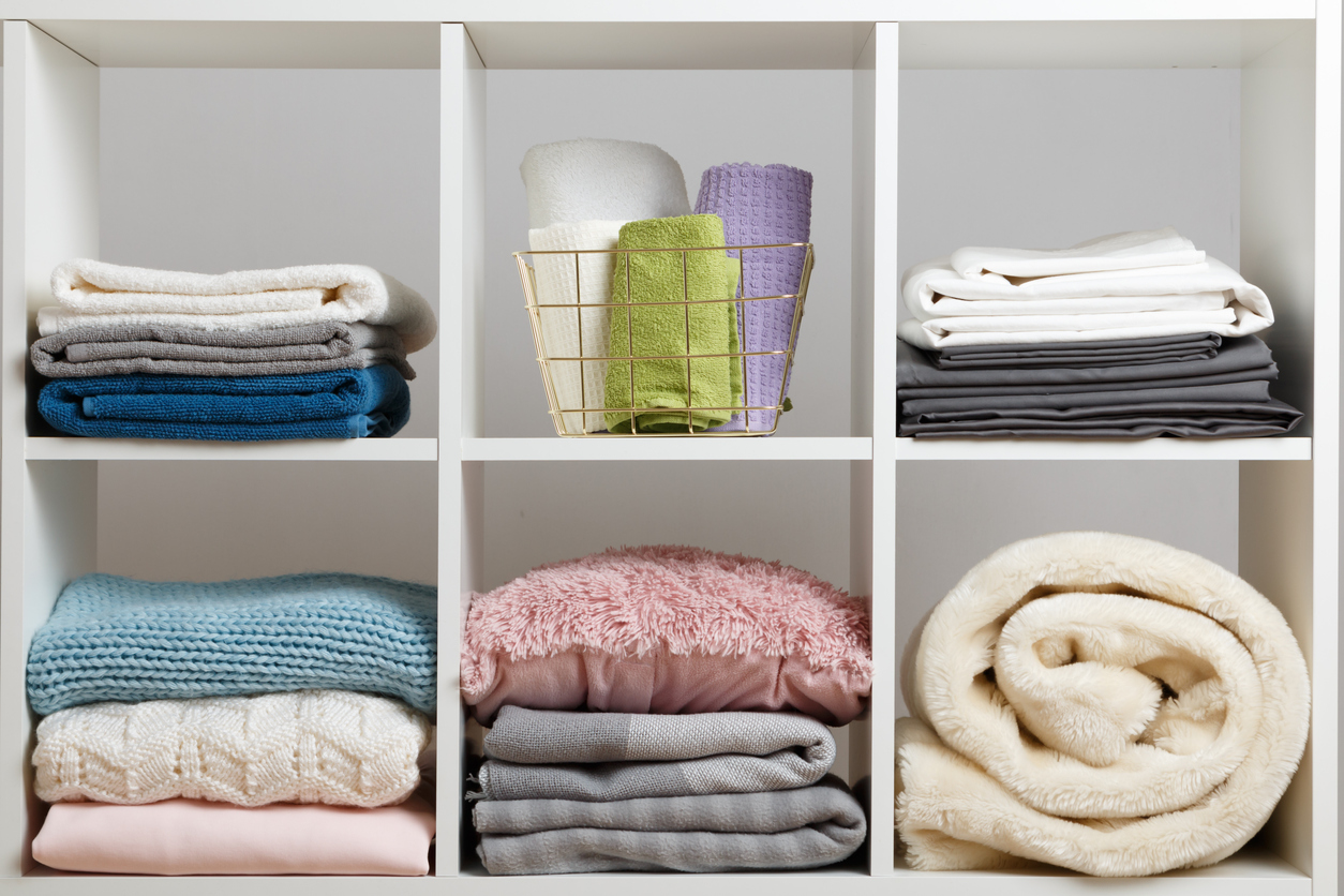 Folded linens in compartments