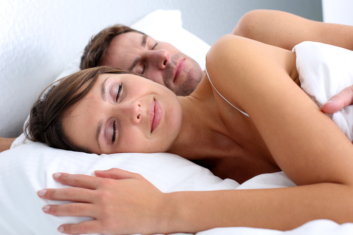 Closeup of couple sleeping on their side