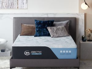 Serta Arctic Hybrid in a room with pillows